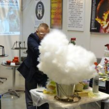 A scientist in a lab creating a smoke clouad