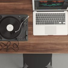 Desk with laptop and turntable