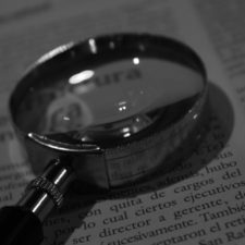 Magnifying glass resting on a book