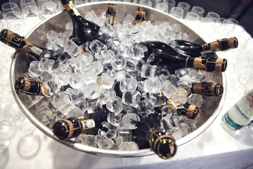 Bucket of iced champagne bottles