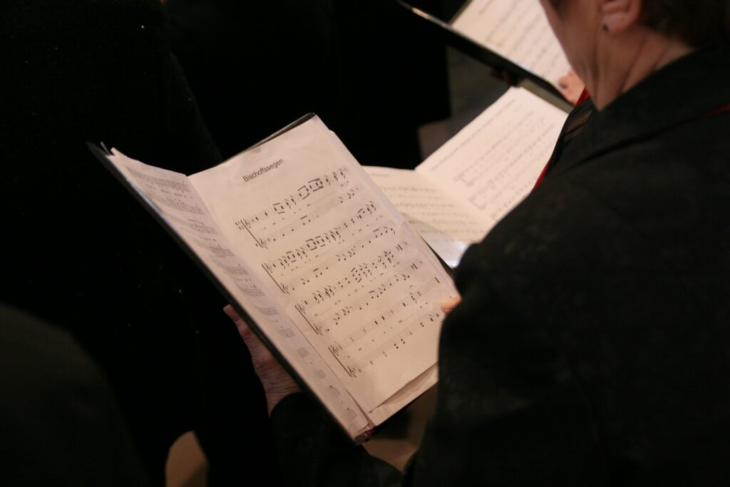 Singer holding a folder of choral music