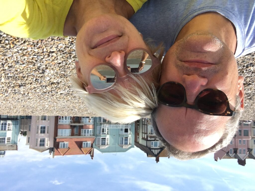 Chris Gillett and Lucy Schaufer sitting on Aldeburgh Beach