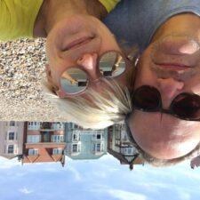 Chris Gillett and Lucy Schaufer sitting on Aldeburgh Beach